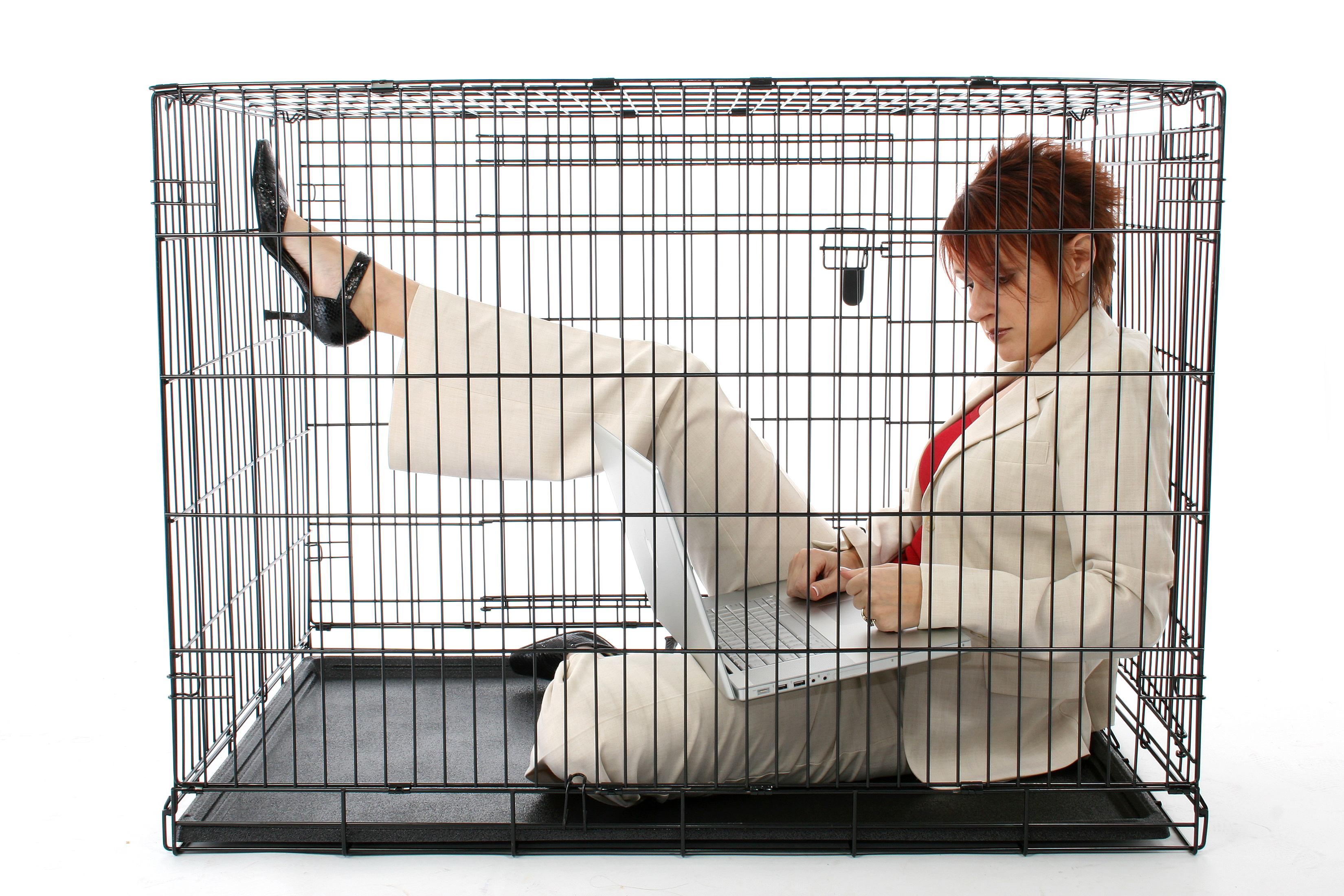 Thirty something business woman trapped in cage.