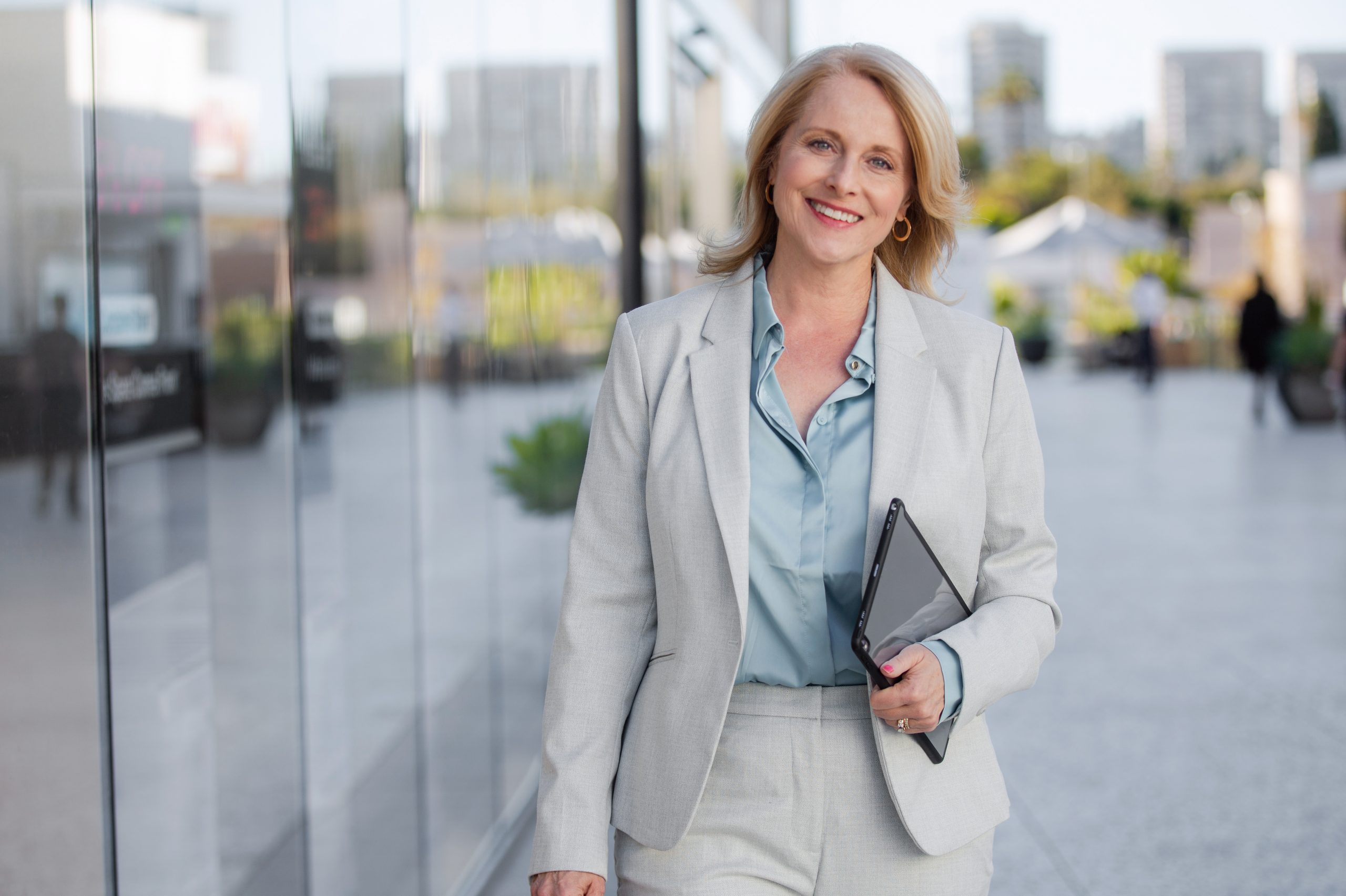CEO business corporate executive, walking confident, cheerful, positive, bright and smiling to office in financial district